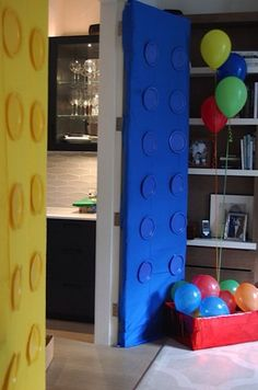 Turn your doors into giant Legos with disposable table cloths and matching paper plates for a Lego-themed party. #BHGREparty