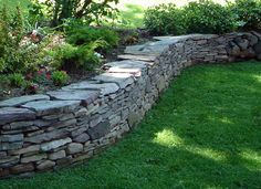 pennsylvania bluestone drystack wall.  This would be nice for your courtyard walls (capped with coping).
