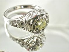 Sale  Fancy Yellow Diamond Ring 14 k White Gold  by RandomJewels, $1950.00