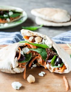 Craving a fast and healthy lunch? This simple sandwich packs a lot of flavor and nutrition, which makes it ideal for an easy weekday meal. I love stuffing leftover ingredients from previous meals into a pita pocket, sprinkling in a little cheese, salt, pepper, and calling it good. Simple, fast and satisfying. Who has time for much more?