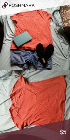 Coral Tee Shirt This simple top is perfect for your casual day. The the pictures so it's slightly more orange than the actual color. Faded Glory Tops Tees - Short Sleeve