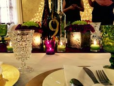 Table numbers on wine bottle.