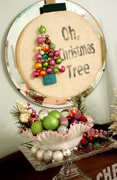 CUTE. I could do that. Christmas tree from ornaments on a embroidery hoop.