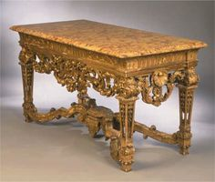 17th century Baroque table, from France. The highly ornate detail and shape of the leg suggests it was Louis XIV.