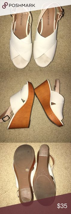 Lucky Brand wedges In excellent condition. These are an off white with tan strap. I've worn them 1x. Almost brand new. So cute with jeans or dress. Open toe and a classic. Lucky Brand Shoes Wedges