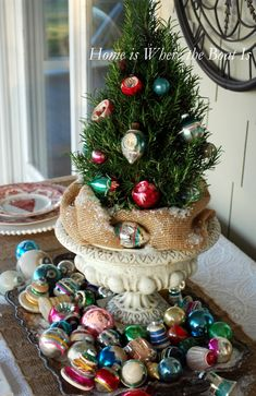 Rosemary Tree in urn with tray of vintage Shiny Brite ornaments | homeiswheretheboatis.net #Christmas #novelbakers