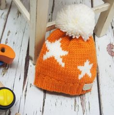 This orange bobble hat, from British designers Blade & Rose, has a cute star print. Organic Baby Clothes, Unisex Baby Clothes, Cute Baby Clothes, Kids Winter Fashion, Kids Fashion, Blade And Rose, British Designers, Newborn Photography Tips, Winter Baby Clothes
