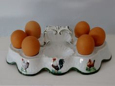Oh this made me swoon! Vintage French Porcelain Chicken & Rooster Egg by Decofanatique, $57.00
