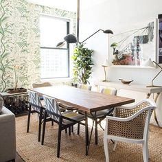 our room crush wednesday knows how to mix it up — tap link in bio to shop CB2 Dylan Dining Table + Tayabas Cane Chair. design: @louisaroeder : @claireesparros
