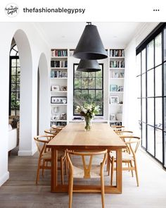 White dining room with large black iron windows and arched doorways. Mid century modern dining room idea, how to decorate your dining room with a century modern feel, mid century modern dining room inspiration Danish Interior Design, White Interior Design, Home Interior, Interior Decorating, Danish Design, Interior Ideas, Decorating Ideas, Decor Ideas, Decorating Websites