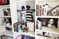 To add a little spice to the living room. Make copies of old family photos. Use Staples to create Blue Print Copies, or Kinkos for Engineers Draft Copies. It makes the photos large enough to fit into the back of a shelf unit. Great way to display past and present family memories.