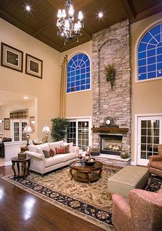 stone fireplace, incredibly high ceilings, spacious living room