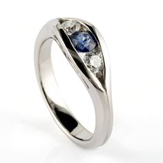 Palladium ring set with 2 round floating diamonds and a blue sapphire by Aimee Winstone Designer Engagement Rings, Diamond Engagement Rings, Bespoke Jewellery, Handmade Wedding, Ring Designs, Sapphire Rings, Blue Sapphire, Bling, Wedding Rings
