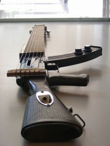 Rock out with the most popular and deadliest weapon world wide – the AK-47. The AK-47 is an actual functional guitar that has been created by modifying a real AK-47. This is a concept item only