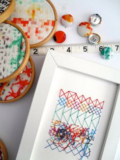Pixel&Thread: Miniature geometric cross stitch 6x4 paper artwork, hand embroidered in colourful cotton thread. Original textile design by Rachel Parker.