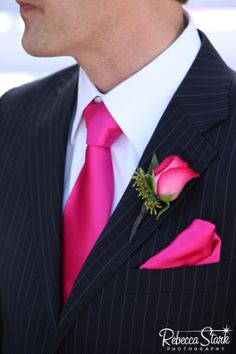 a groom with hot pink accessories