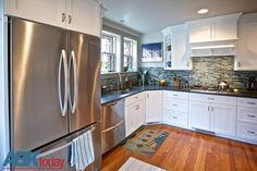 Stainless appliances blend beautifully with the white cabinets and #tile backsplash. #kitchens #abktoday #Pennsylvania #homeremodels #kitchendesigns