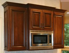 microwave oven with cabinets above and on both sides possibly in that awkward corner??