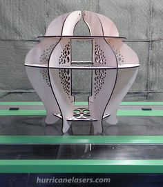 MakerPlace member Bill Watson made this lamp on the laser. There will be a shade in the center and the light will shine through the cut-outs.