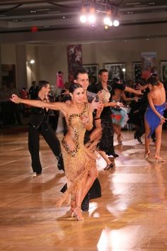Briana and Igor in Custom Artistry in Motion Latin Dress and Men's Shirt