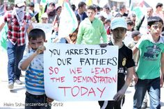 """Palestinian children from the village Kufr Qadum, whose fathers were detained by Israeli soldiers, carry on the protest: """"You Arrested Our Fathers, So We Lead the Demonstration Today"""""""