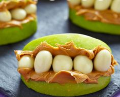 Use apples, peanut butter and yogurt-covered raisins to make these monster mouths.