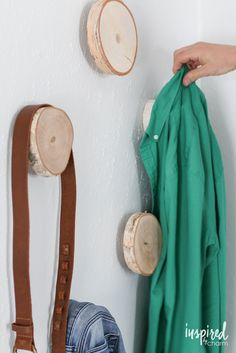 DIY Birch Hooks | Inspired by Charm. Stumps as wall hooks. Clothes don't get that weird hook bump at the collar. Fantastic for my cardigan addiction.