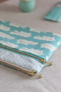 Sew an easy double zipped pouch with two compartments with this free sewing tutorial from Japanese Sewing Books. I was able to find the gold zippers with pulls here! Watch the video below: Get step-by-step sewing instructions to read here.