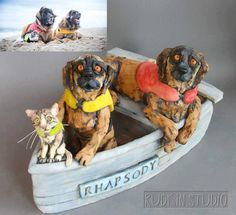 Yes, it's a custom pet sculpture of a swimming cat and two Leonberger friends who enjoy water sports together: https://www.facebook.com/RudkinStudio