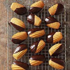 Chocolate-Dipped Pumpkin Madelines From Better Homes and Gardens, ideas and improvement projects for your home and garden plus recipes and entertaining ideas. Vanilla Recipes, Sweet Recipes, Baking Recipes, Cookie Recipes, Dessert Recipes, Fall Desserts, Baking Tips, Cocoa Cookies, Galletas Cookies