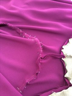 Step 15: then sew with a cm seam allowance, start at the shoulder seam and double back then sew out.
