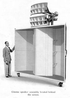 a funny looking vintage big ass sound system on wheels Western Electric Theatre Loudspeaker.