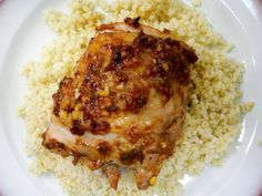 Suvir Saran's Spicy Roasted Chicken Thighs  garlic, ginger, jalapeno pepper, lemon, tomato paste, cumin powder, coriander seeds => process to paste => rub => refrigerate for up to a day => roast in 400 degrees oven for 45 minutes