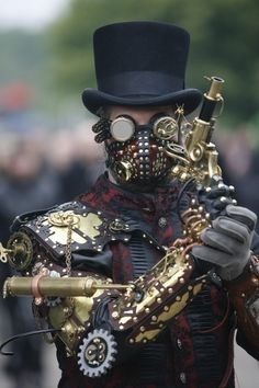 A steampunk participant attends the Wave Gothic Festival on May 2009 in Leipzig, Germany. (May 2009 - Photo by Getty Images/Getty Images Europe) Steampunk Cosplay, Chat Steampunk, Moda Steampunk, Viktorianischer Steampunk, Steampunk Kunst, Steampunk Design, Steampunk Clothing, Steampunk Assassin, Steampunk Outfits