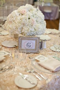 Dinner table arrangement / white hydrangeas with peonies tucked in (no roses) in varied height mercury glass vases / also love these table number holders (can we find something similar)