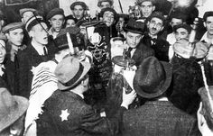 Members of the Zionist Youth Front and the Tchiya youth movements celebrating the Simchat-Tora holiday in the Lodz Ghetto. Poland, 1943