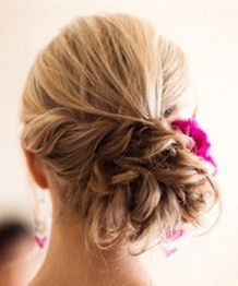 Gorgeous wedding or prom updo idea-- twisted, low bun with a bright flower!  Get the perfect updo for your next special occasion at the best salon in Phoenix's West Valley-- David Gerard Salon in Goodyear.  Schedule your consult and appointment now!  http://davidgerardhairsalon.com/