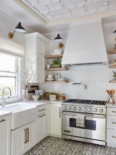 This kitchen feels like me. Good lights, white and wood color scheme, and kitchen plants. Wonderful.