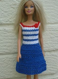 I improvised my crochet dress pattern to make this nautical theme dress for Barbie Free pattern at http://linmary123.blogspot.com/2014/05/barbie-crochet-nautical-dress-free.html