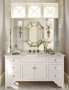 antiqued mirror tiles on the wall behind the vanity