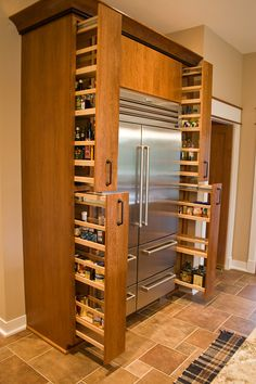 I have a huge pantry that things get lost in, I wonder if I could modify it a bit and have something like this. Pull out spice cabinets beside refrigerator? We had mentioned that there is space on both sides of our new LG refrigerator.