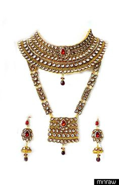 Traditional Indian Bridal Set with all the accessories. Ethnic Kundan Work with meenakari and red color stones for a perfect bridal look.
