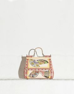 Dolce&Gabbana Medium Sicily Bag in Dauphine Print Foulard $2,395.00  This is a great editorial piece.  How it would translate to everyday is another matter?