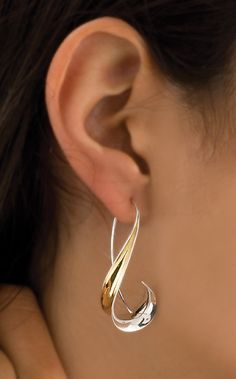 """When I get into gold! """"Long Hook Earrings"""" Silver & Gold Earrings Created by Nancy Linkin Sophisticated curves forged from sterling silver and gold bimetal using the anticlastic technique. Sterling Silver Jewelry, Gold Jewelry, Unique Jewelry, Jewelery, Fine Jewelry, Handmade Jewelry, Jewelry Design, Gold Bracelets, Gemstone Jewelry"""