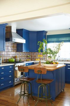 The sapphire-inspired shade on the kitchen cabinets (Benjamin Moore's California Blue) could have easily overwhelmed the compact cook space. The key to its success? Fearlessly using it in abundance paired with fun patterns.