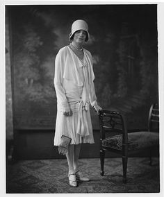 FLAPPER STYLE...Portrait of black woman dressed in flapper style. Addison Scurlock, photographer.