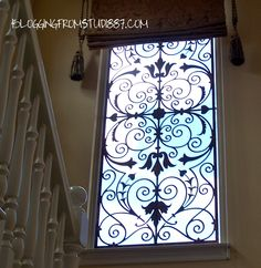 grand stair case...yes that is a finish not iron on the window...