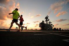 Sailors run on flight deck of USS George H.W. Bush