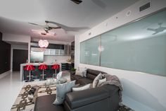 "Our client and owner of VERO Water, was eager to completely renovate his unit to create the ultimate ""bachelor pad"" with a South Beach vibe. With a clear vision determined from the start, selecting all finishes and furnishings with the client allowed us to truly turn his ""bachelor pad"" goal into a ""bachelor palace""."