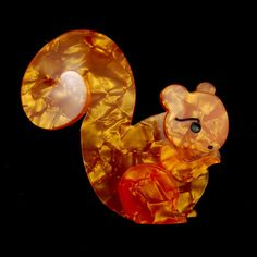 Orange Saskia Squirrel Pin:Orange Saskia squirrel has such a big beautiful tail! This orange multi layer resin squirrel pin has bar pin back and measures approximately 2.75 inches wide and 2.5 inches long. Comes in a darling Erstwilder gift box! (She does not have a story inside) $24.00